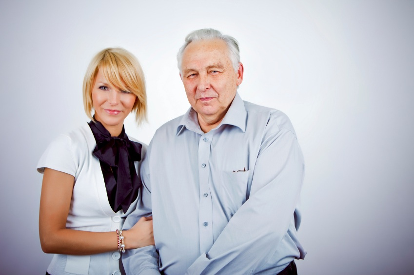 Generational Retirement Savings: A young woman stands next to an eldery man.