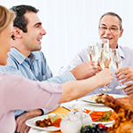 A family making a toast over a holiday meal