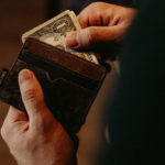 Savings research, dollar in wallet