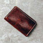 A worn leather wallet to illustrate health and financial wellbeing