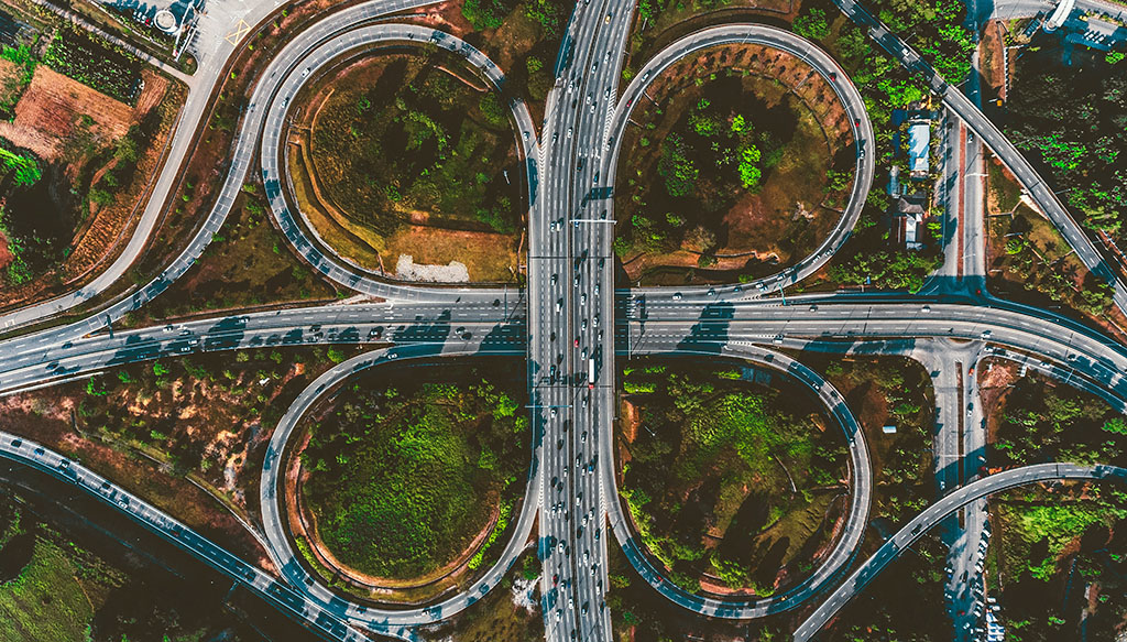 The concept of Industry intersections illustrated by a looping intersection of highways in Malaysia