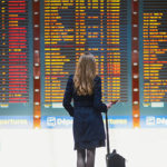 Travel industry thought leadership: a woman business traveler in an airport