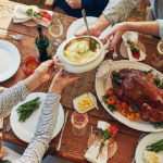Family Giving Traditions for Thanksgiving, food shared over a dinner table, from Fidelity Charitable