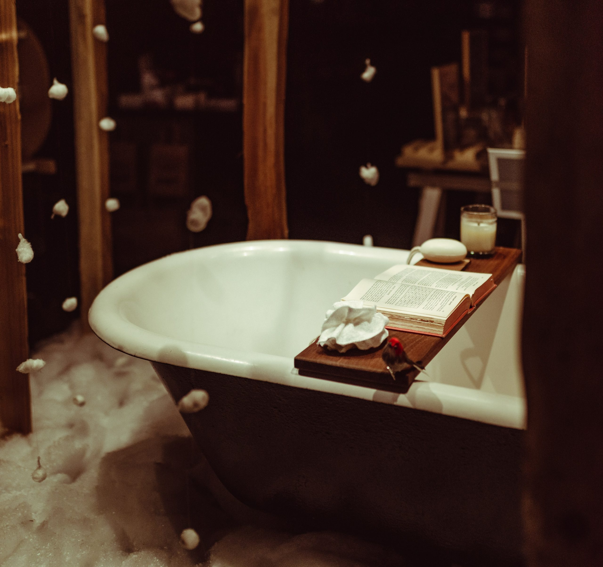 Cure for the COVID blues: A relaxing bath tub set up with a book