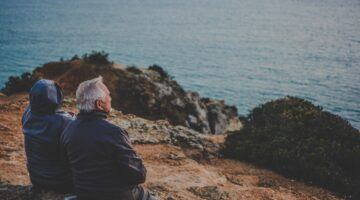 Retirement age investors look out over a body of water